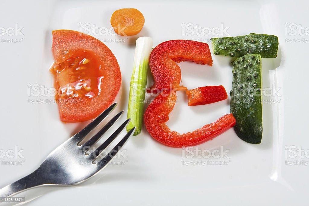 Placa con verduras y una dieta sobre fondo de madera - Foto de stock de A cuadros libre de derechos