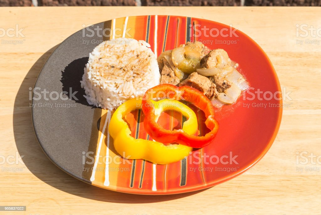 Plated Filipino Style Pork Adobo with Jasmine Rice stock photo
