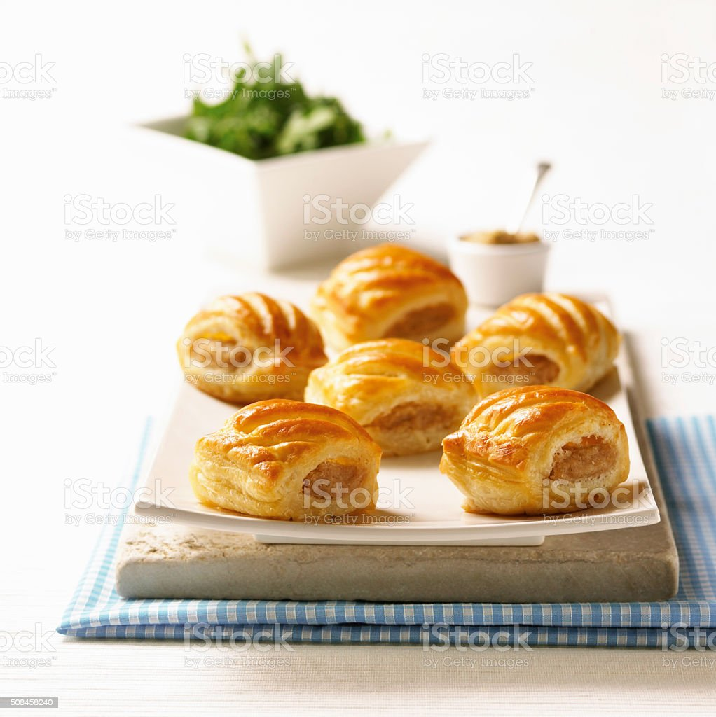 Plated home made sausage rolls with side salad and dip. stock photo