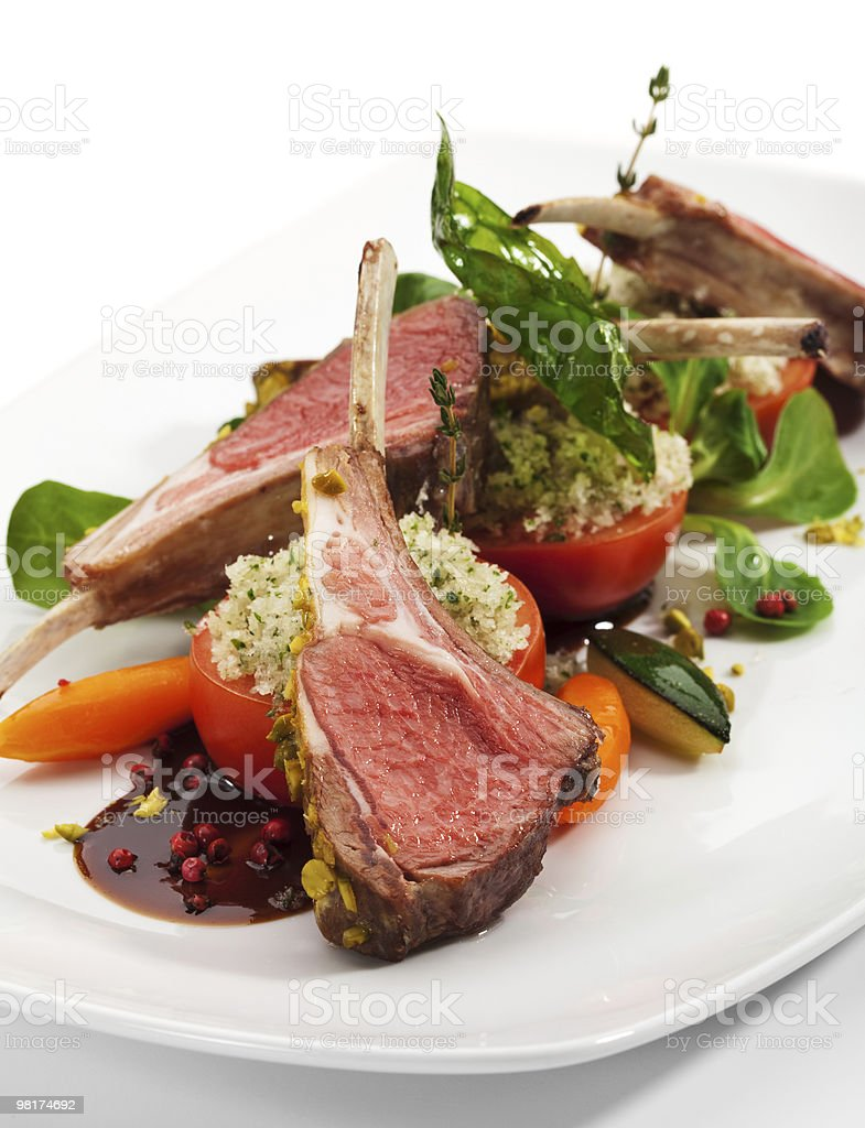 A plated lamb chop with summer steamed vegetables and glaze royalty-free stock photo