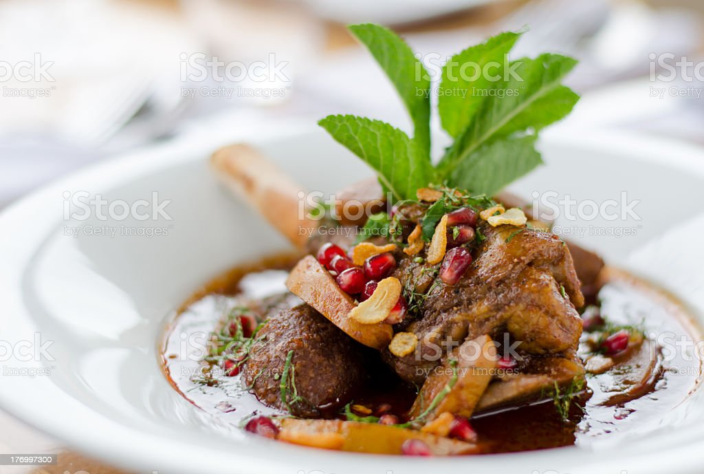 Plated leg of lamb on a white plate stock photo