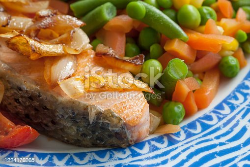 Plated red salmon dinner with fresh seasonal vegetables