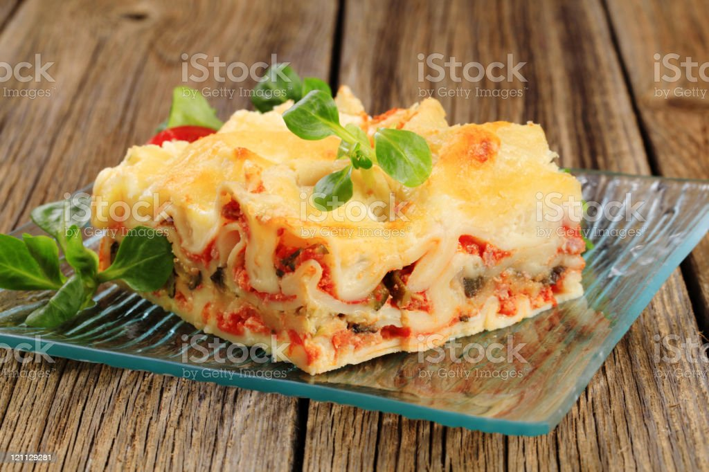 Plated slice of lasagna with garnish royalty-free stock photo