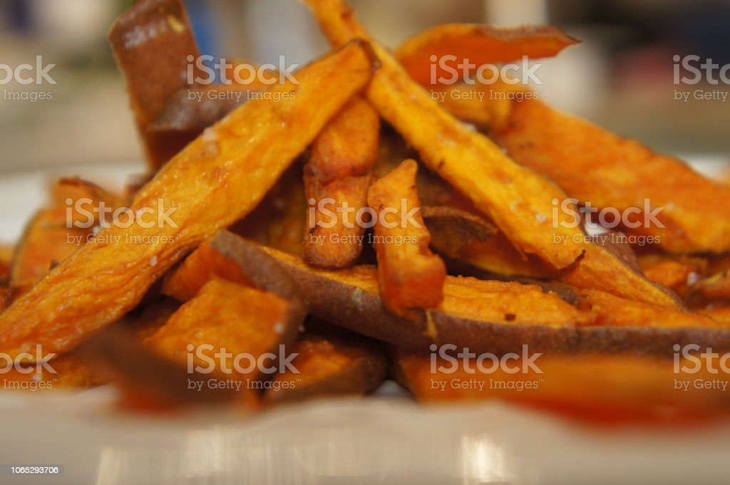 A plateful of yam or sweet potato fries stock photo