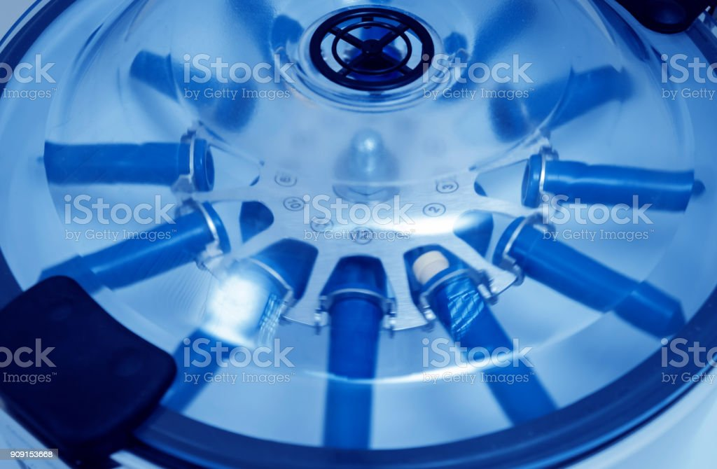 Platelet-Rich plasma preparation. Tube with blood in centrifuge. stock photo