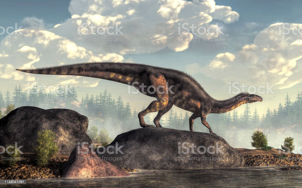 Plateosaurus A plateosaurus stands on a large rock on the shore of an ancient lake.  This bipedal dinosaur leans forward to rest its hands on the ground as it looks out across the water. 3D Rendering Ancient Stock Photo
