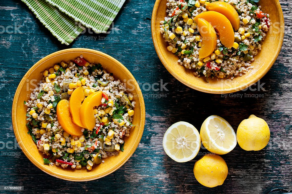 Plates Of Bulgur And Vegetables Salad stock photo