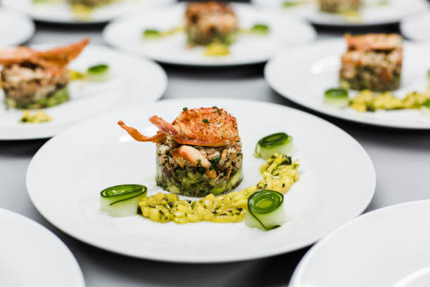 plates with lobster risotto in a restaurant - food styling stock photos and pictures