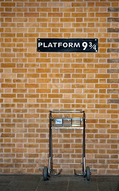 Platform 9 3/4 and Trolley Platform 9 3/4 & Trolley railroad station platform stock pictures, royalty-free photos & images