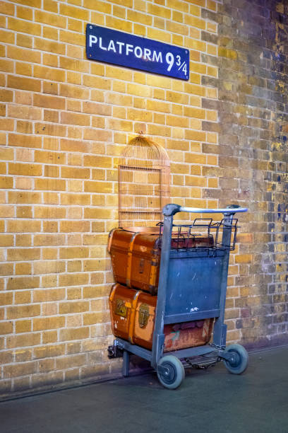 Platform 9 3/4 at King's Cross Station in London, Uk London, UK - May 12 2018: Platform 9 3/4 that taken from Harry Potter movie in King's Cross station subway platform stock pictures, royalty-free photos & images