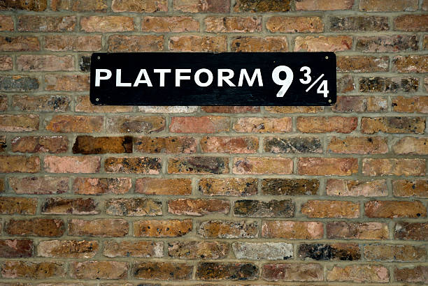 Platform Nine and Three Quarters The platform at King's Cross Station in London made famous by the Harry Potter Books. railroad station platform stock pictures, royalty-free photos & images