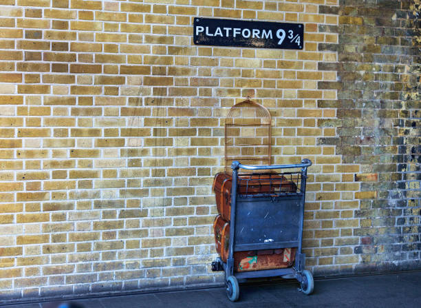Platform nine and three-quarters at King's Cross station, London London, UK - February 24, 2018: Platform nine and three-quarters at King's Cross railway station, London, made famous in J K Rowling's Harry Potter series of books and films. subway platform stock pictures, royalty-free photos & images