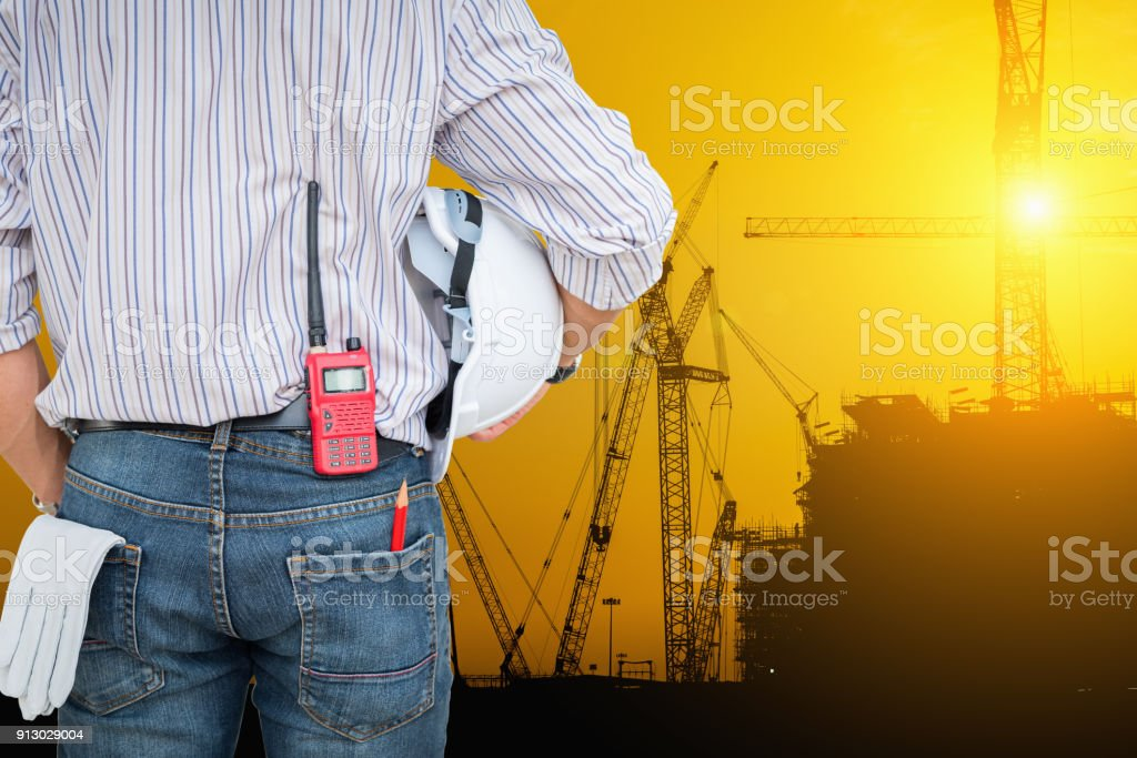 Platform oil rig fabrication site and silhouette of construction activities stock photo