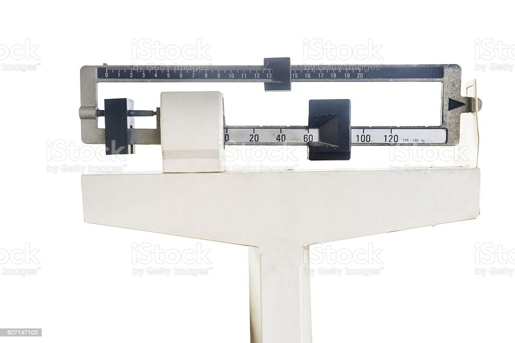 platform scales iron weighing machine isolated on white stock photo