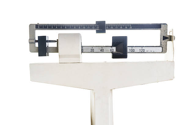 platform scales iron weighing machine isolated on white stock photo