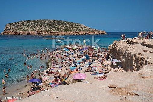 Ibiza, Spain - September 03, 2019  : Tourists sunbathing at Platges de Comte