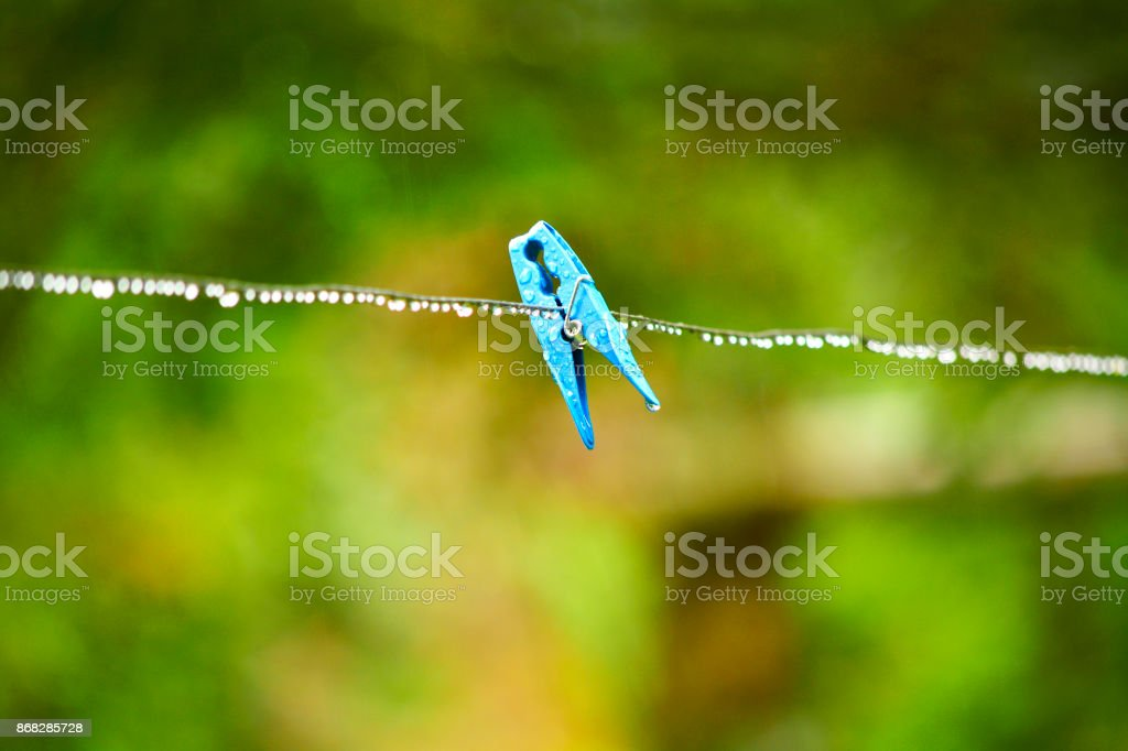 Platic clothespin in nature stock photo