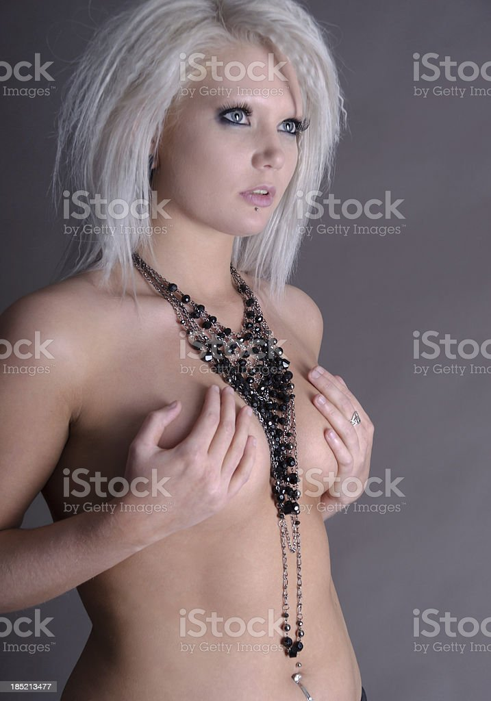 Platinum blonde model in black necklaces. royalty-free stock photo