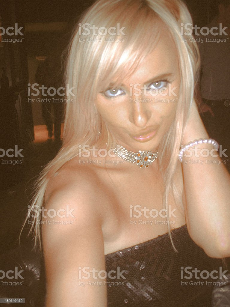 Platinum Blonde taking a sultry self portrait. stock photo