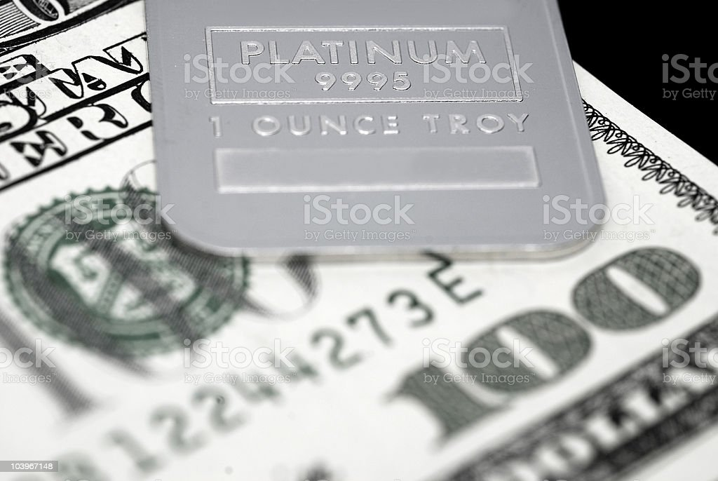 Platinum ingot and US currency royalty-free stock photo