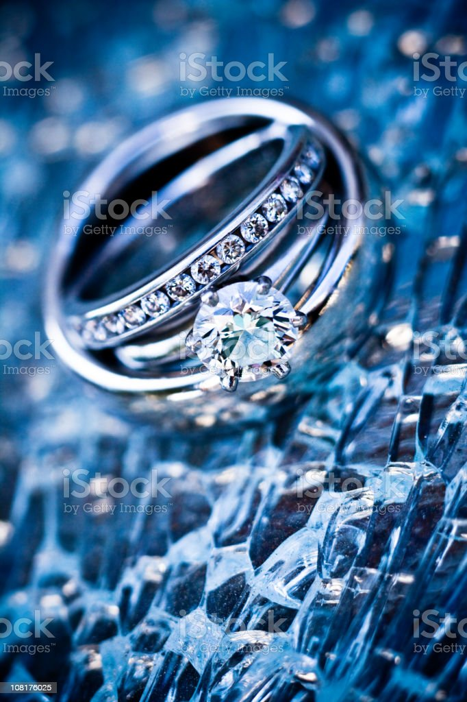 platinum rings on shattered glass (dark blue) royalty-free stock photo
