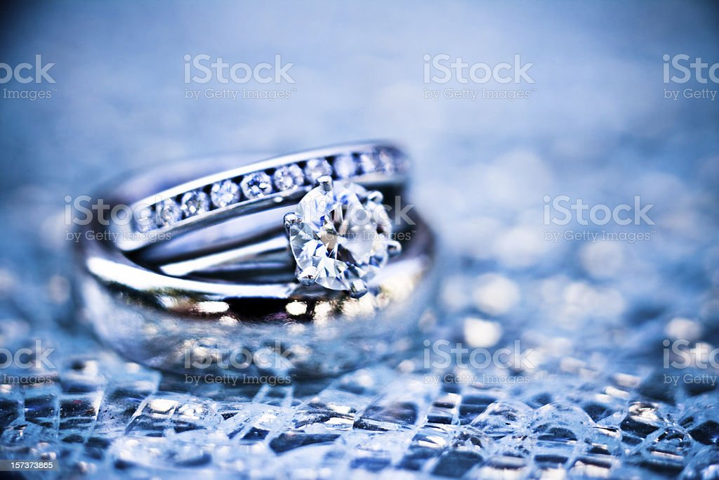 platinum rings on shattered glass (ice blue) stock photo