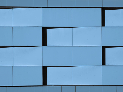 Close-up of a minimalist blue facade with geometric shapes Plattenbau