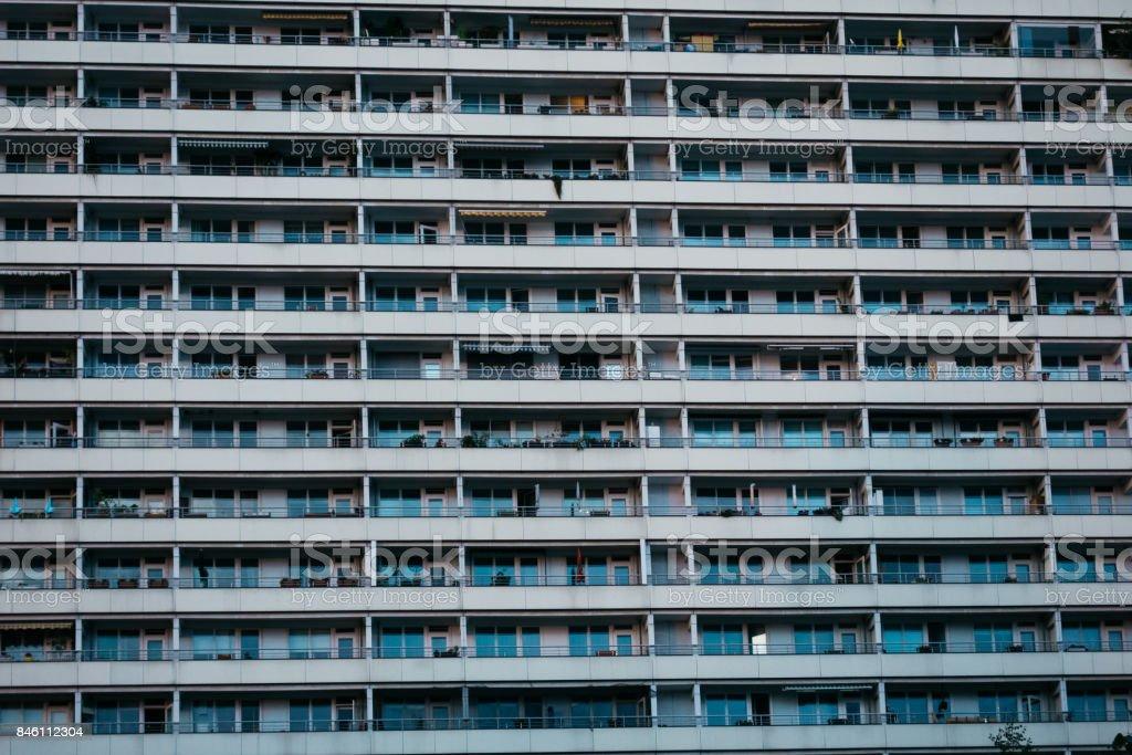 plattenbau facade with long balcony stock photo