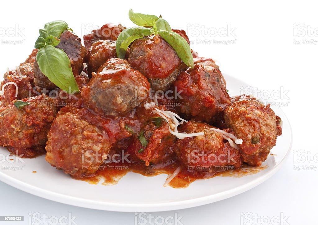 Platter full of meatballs in tomato ragu sauce royalty free stockfoto