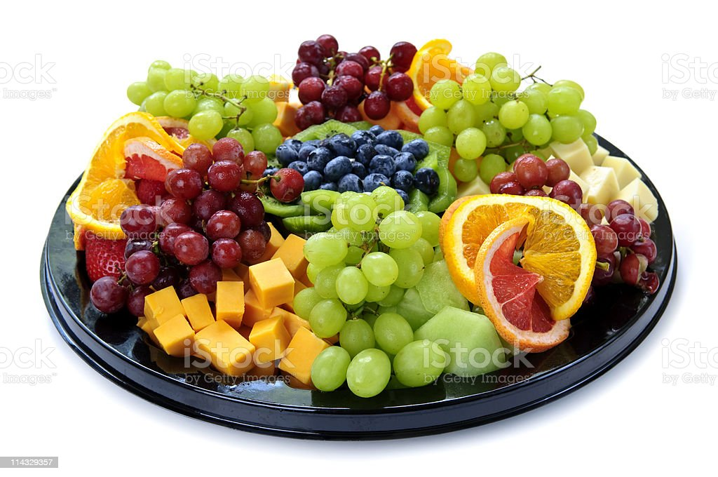 A platter of a variety of different fruits stock photo