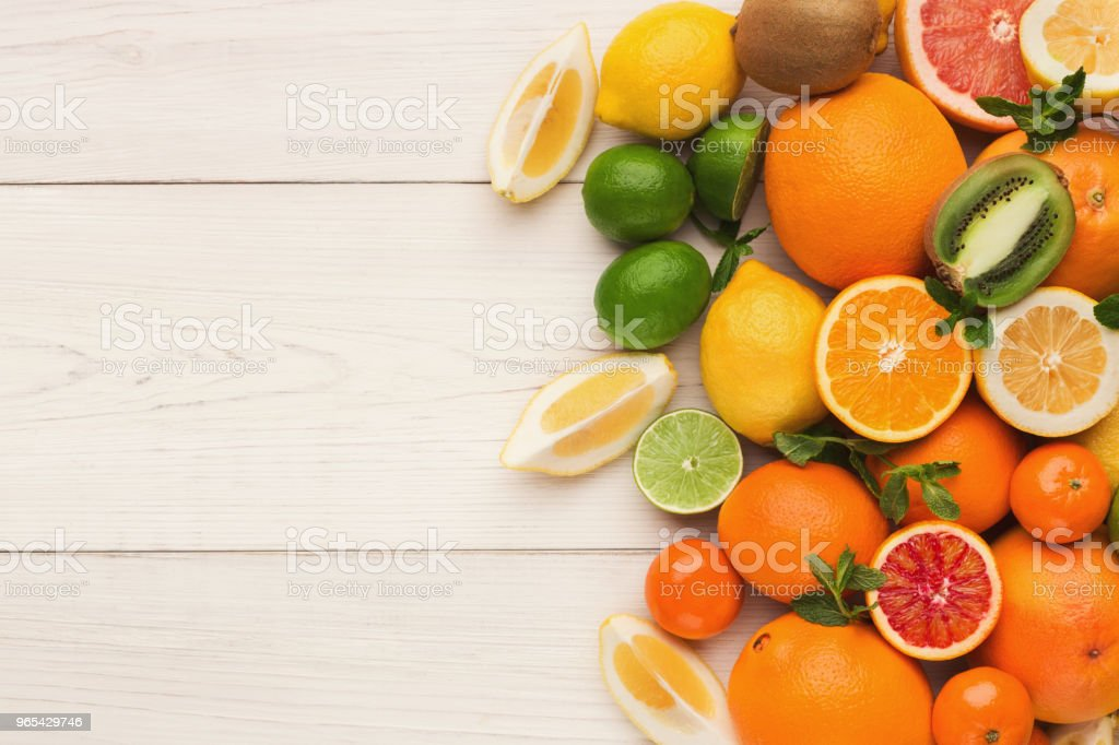 Platter of assorted citrus fruits on white wooden planks, top view royalty-free stock photo