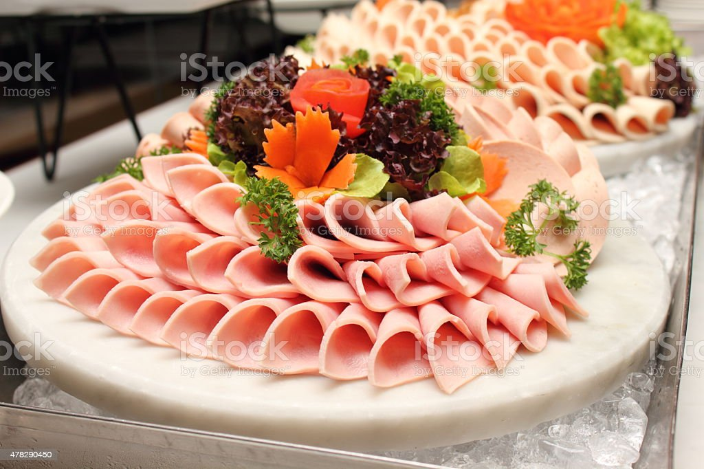 Platter of assorted cold cut slices. stock photo
