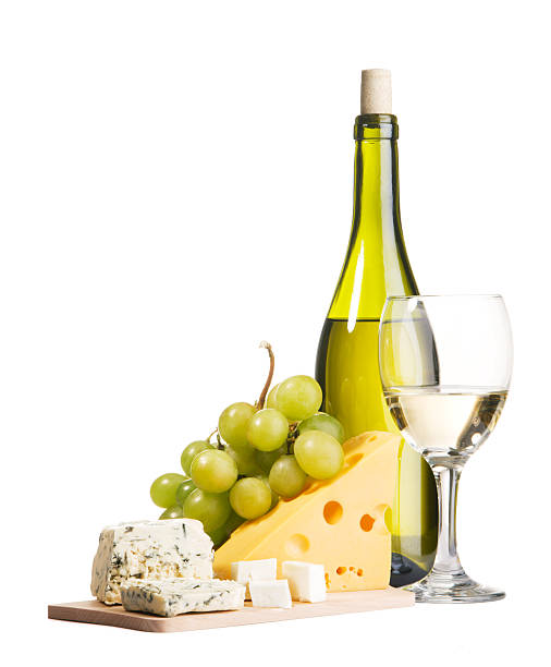 A platter of cheese and grapes with wine stock photo