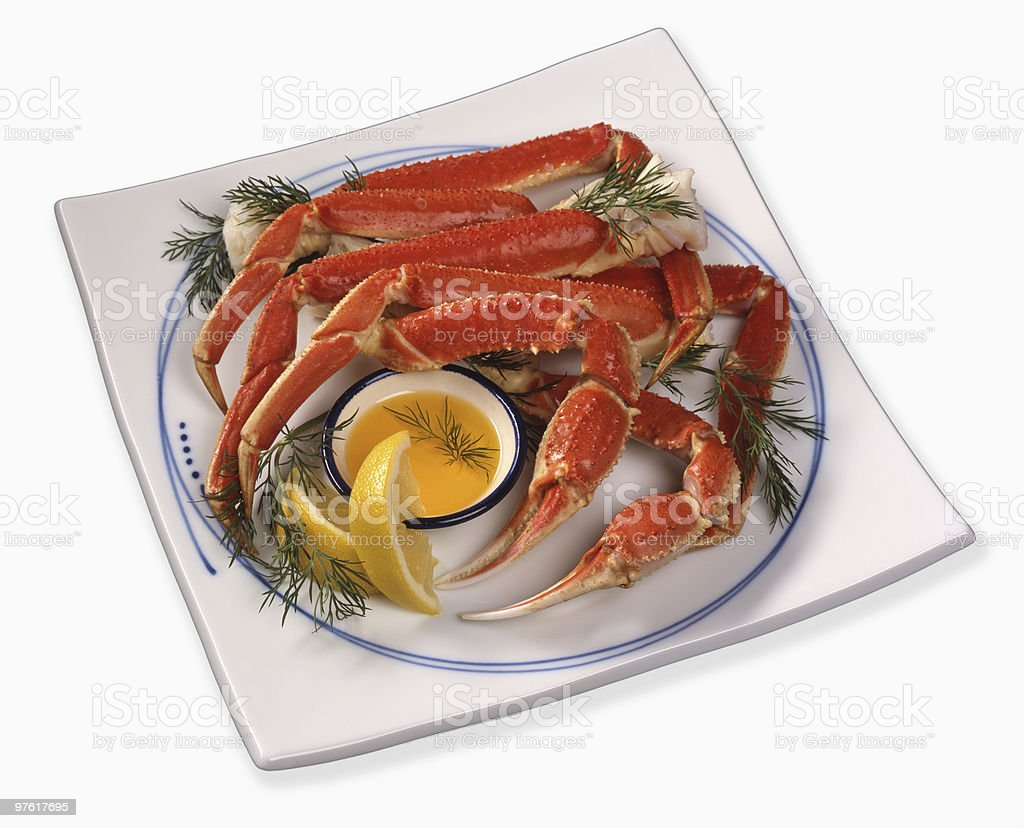 Platter of King Crab Legs with Butter and Lemon royaltyfri bildbanksbilder