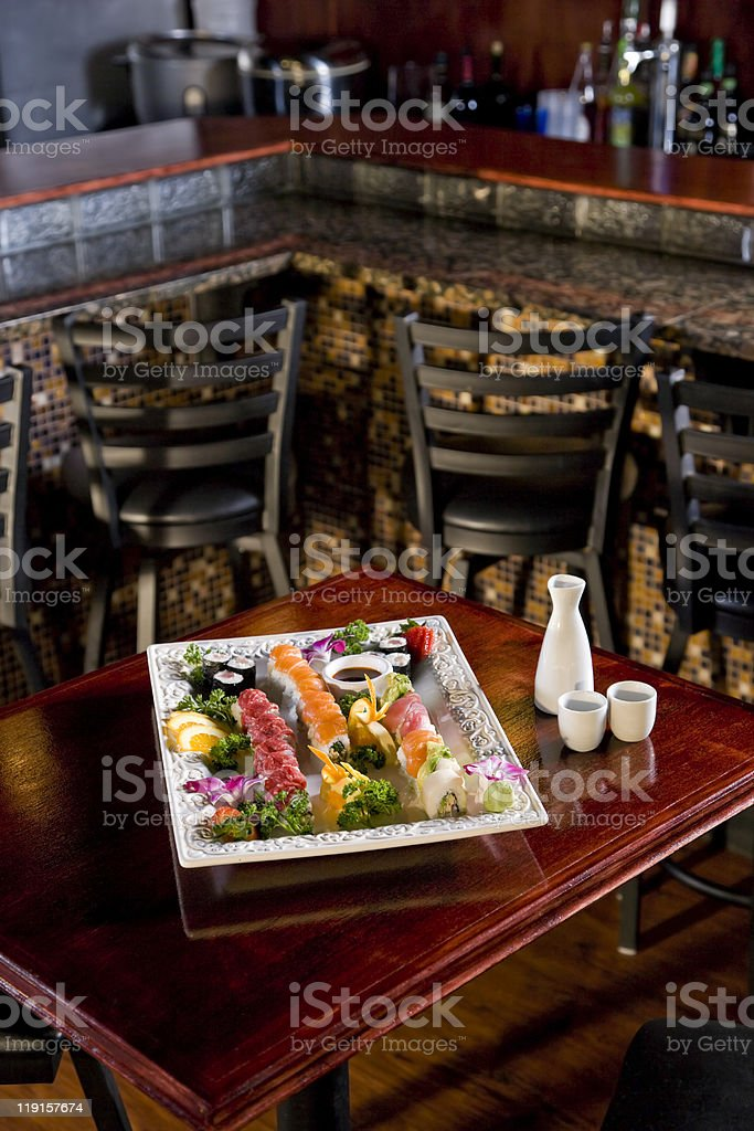 Platter of sushi on table in Japanese restaurant royalty-free stock photo