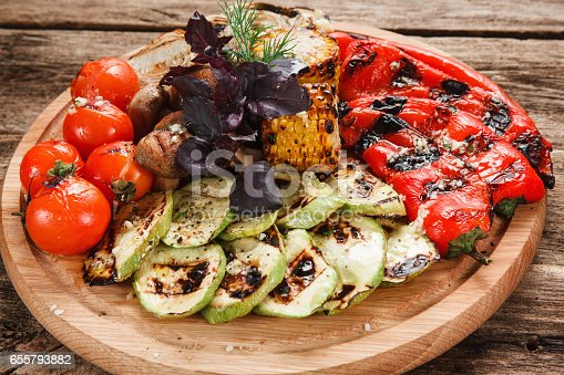 655793486 istock photo Platter with appetizing vegetables cooked on grill 655793882