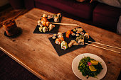 Japanese sushi platter with a variety of sushi rolls and sashimi