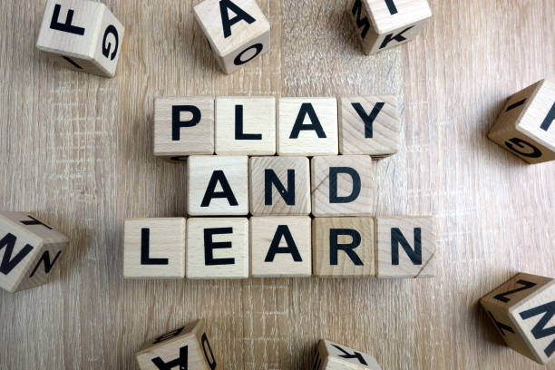 Play and learn text from wooden blocks stock photo