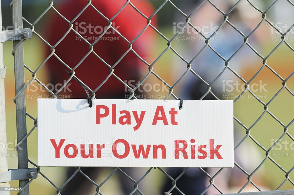 Play at your own risk sign stock photo