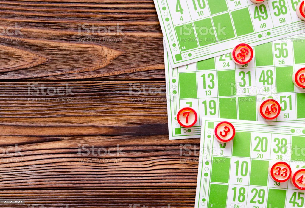 play bingo on wooden table stock photo