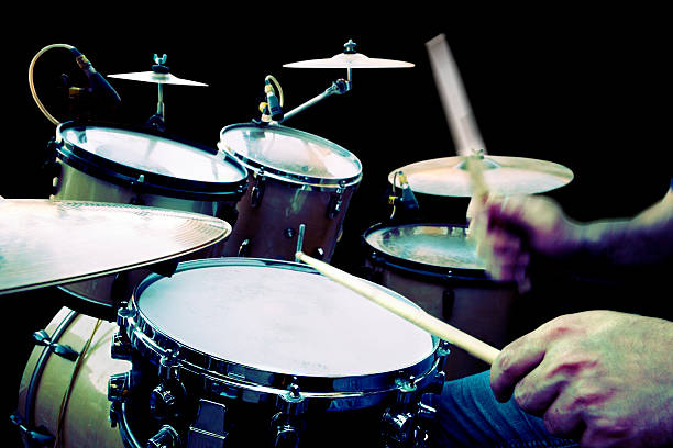 Play drum drummer playing isolated over black background drum kit stock pictures, royalty-free photos & images
