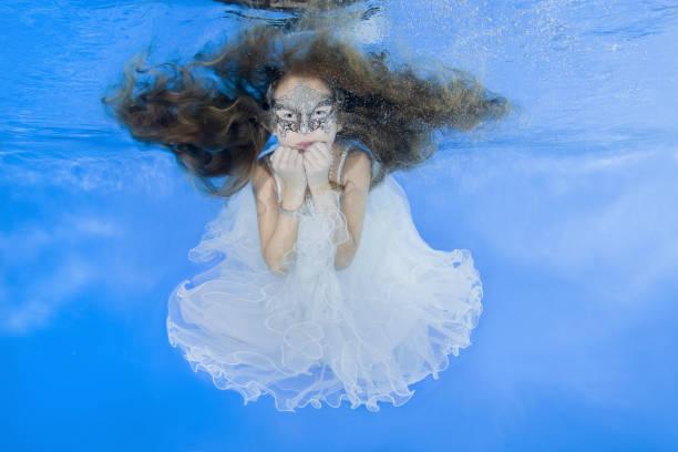 Play fashion junior - under water stock photo