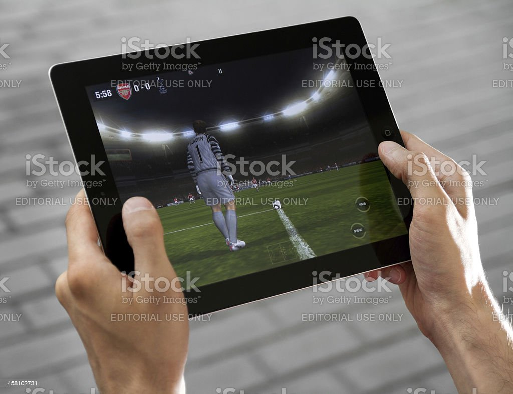 Play FIFA football on Apple Ipad2 stock photo