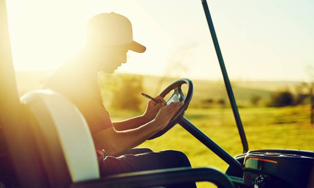 Play more, improve your score Shot of a young man recording his score during a round of golf scoring stock pictures, royalty-free photos & images