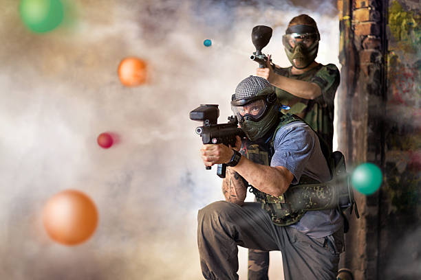 Play paintball game stock photo