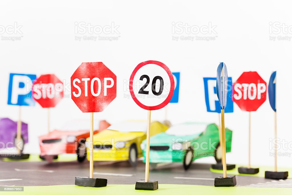 Play set of toy speed-limit and stop road signs stock photo