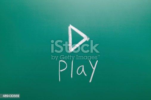 istock play sign drawn with chalk on blackboard 489430559