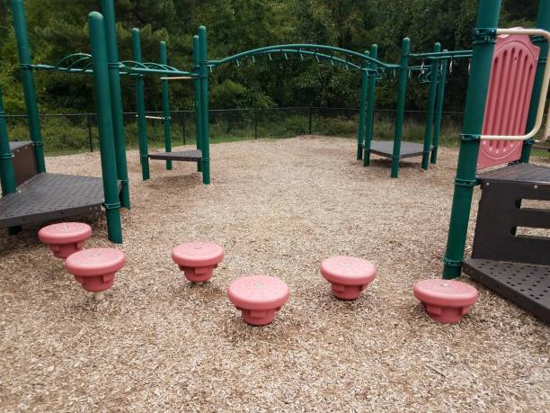 play structure with green bars and red stepping stones stock photo