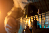 Play the guitar, close up
