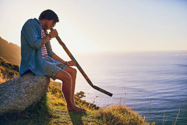 play the song that's in your soul - didgeridoo stock photos and pictures
